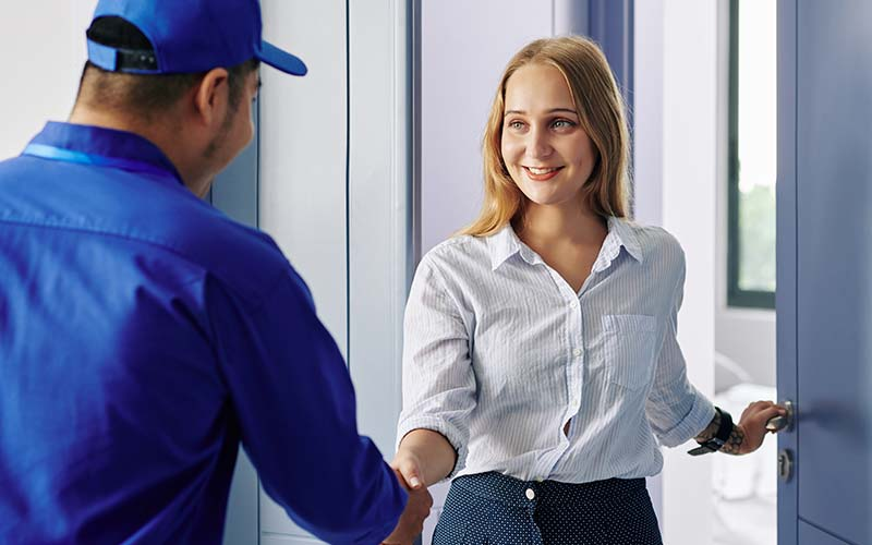 salesman at door greeted by woman