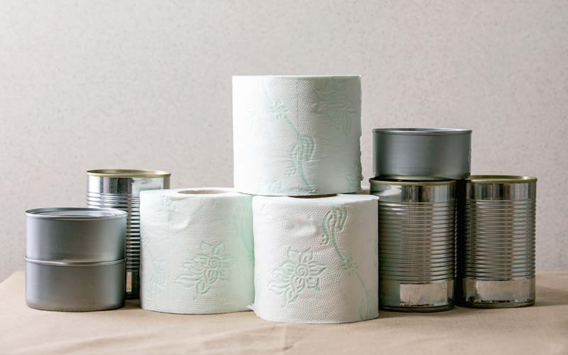 image of toilet paper and unmarked canned goods as commodities