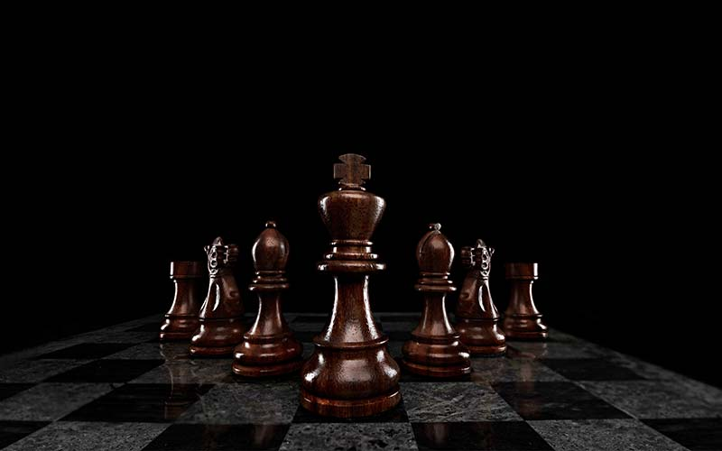 Seven chess pieces lined up to illustrate seven habits